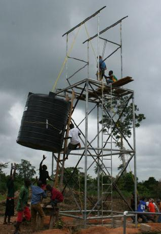 Hoisting up the water tower tank.